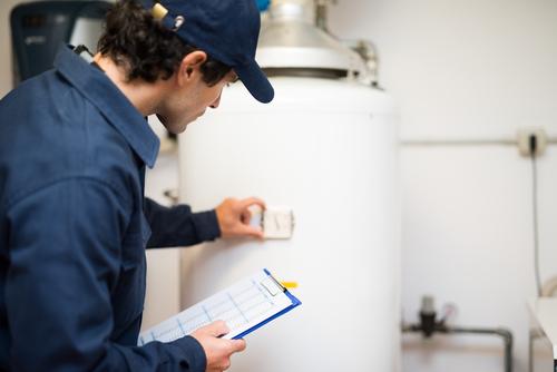 man replacing water heater